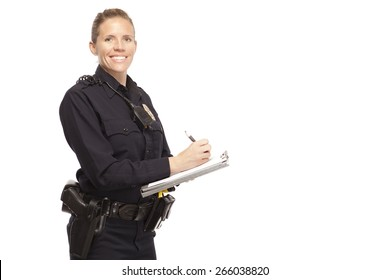 Happy female police office writing report against white background