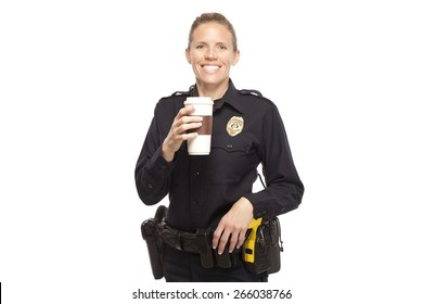 Happy female police officer with disposable coffee cup