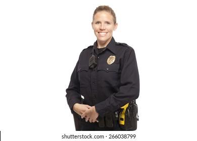 Happy female police officer posing against white