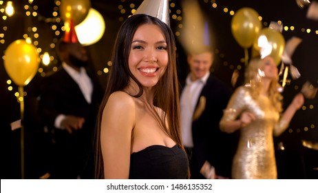 Happy female posing for camera at party in night club, birthday celebration