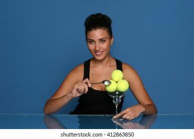Happy Female Sportswoman with tennis balls