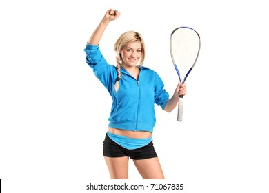 A happy female squash player posing isolated against white background
