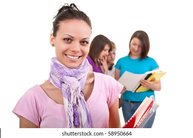 happy female student with books and friends in back