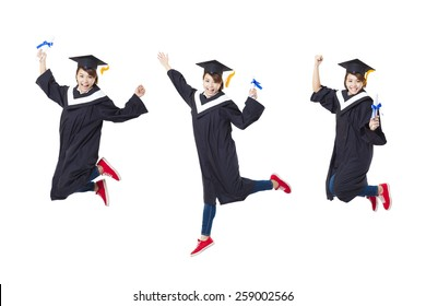Happy female student in graduate robe jumping against white background