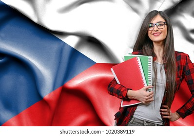 Happy female student holdimg books against national flag of Czech Republic