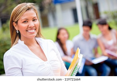 Happy female student at the university with group of friends