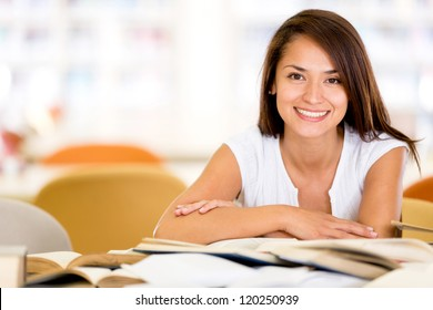 Happy female student at the university smiling