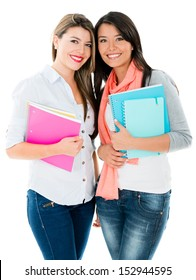 Happy female students wih notebooks - isolated over white background