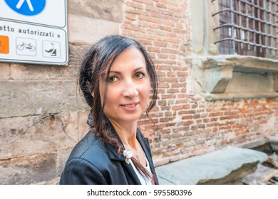 Happy female tourist visiting Italy.