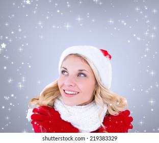 Happy festive blonde against grey vignette