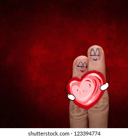 the happy finger couple in love with painted smiley and hold heart