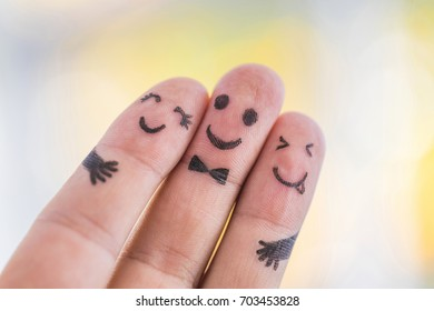 Happy finger family group on blurred background