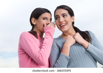Happy firends talking on secret