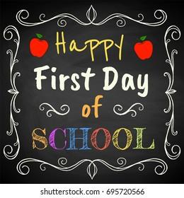 Happy First Day of School. Chalk text on blackboard.