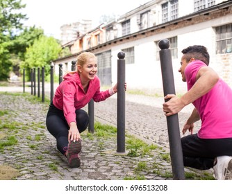 Happy Fit couple doing exercises