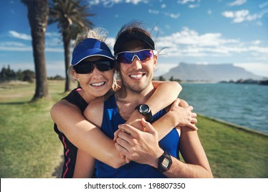 Happy fitness couple portrait while training in the park for marathon run