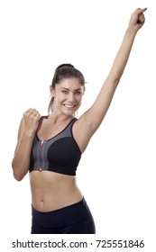 happy fitness woman with her arm up in the arm