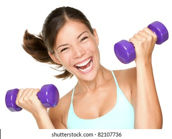 Happy fitness woman lifting dumbbells smiling cheerful, fresh and energetic. Mixed race Asian Caucasian fitness girl training isolated on white background.