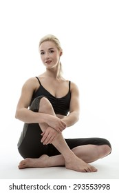 happy fitness woman sitting on the ground