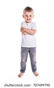 Happy five year old European boy posing over white studio background