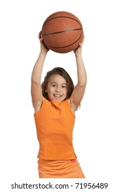 Happy five year old girl playing with basketball