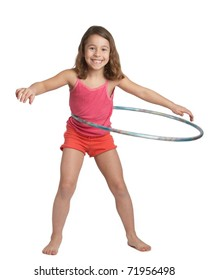 Happy five year old girl with hula hoop on white