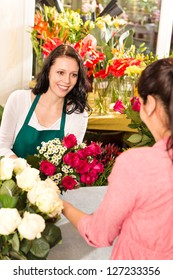 Happy florist making roses bouquet women customer buying flower shop