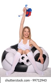 happy football and soccer fans in an armchair on white background