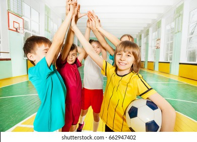 Happy football winners giving high five together