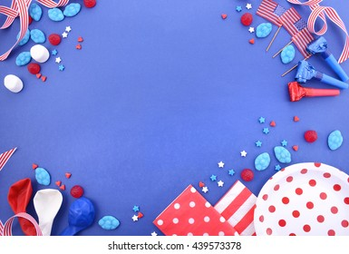 Happy Fourth of July BBQ and party background with decorated borders in red, white and blue theme colors, with copy space.