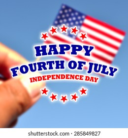 happy fourth of july - independence day card on de focused american flag in blue sky background