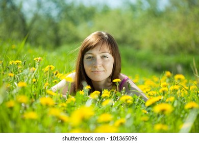 Happy  freckle woman relaxing in   park