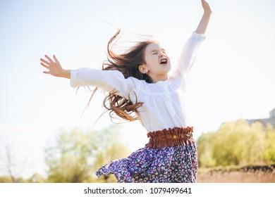 Happy free Kid Winner Hands up outdoor
