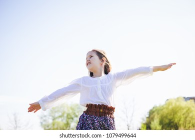 Happy Free Kid Winner Hands up outdoor enjoy life