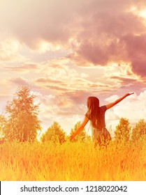 Happy free woman enjoying happiness, freedom and nature.