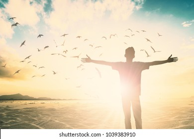 Happy freedom prayer man life with hands rise up to worship god on morning sunrise view. concept hope wellbeing praise easter day, office Men joyful in financial freedom out workplace.