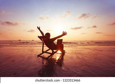 happy freelancer with laptop computer working on the beach, freelance work concept, dream office job workplace