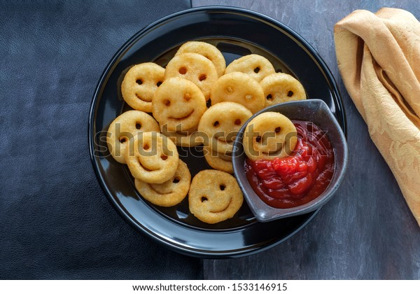 Happy French fried potato smiley faces with ketchup
