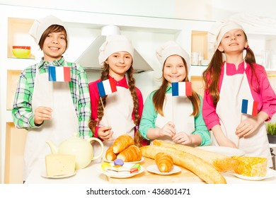 Happy French team of four young bakers