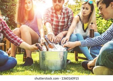 Happy frends drinking in garden