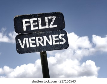 Happy Friday (In Spanish) sign with clouds and sky background
