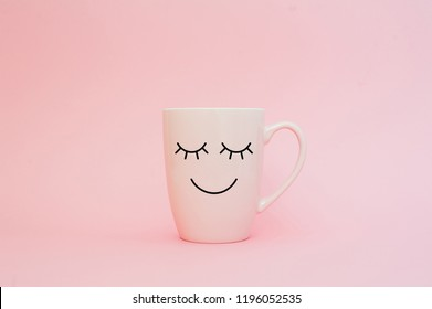Happy friday word. Cup of coffee on pink background with smile face on mug. Concept about love and relationship. Creative colorful greeting card.