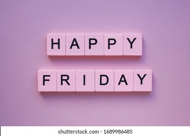 Happy friday words wooden cubes on a pink background