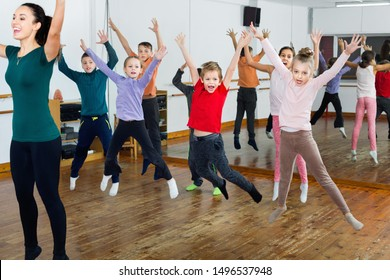 Happy friendly smiling children dancing contemp in studio smiling and having fun