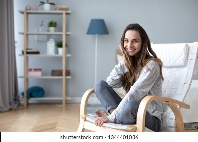 Happy friendly woman posing indoor at home in casual clothes. Lifestyle female portrait at home.