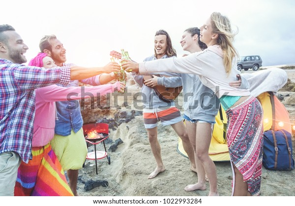 Happy Friends Cheering Beers Barbecue Dinner | People Stock