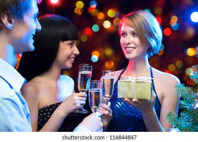 Happy friends congratulate each other on Christmas