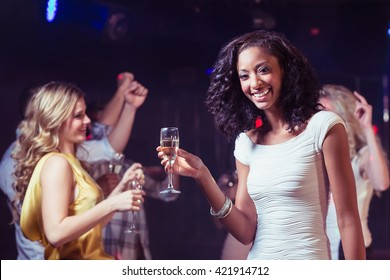 Happy friends dancing in a club