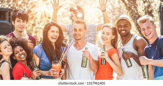 Happy friends from different countries at summer party outdoor - Young people having fun together at music festival - Friendship, youth and vacation concept - Focus on center guys faces