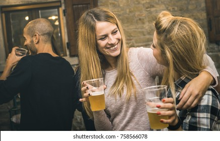 Happy friends drinking beer at house party - Friendship concept with fancy people having fun together - Young women sharing joy moment celebrating at home - Warm retro filter with focus on middle girl